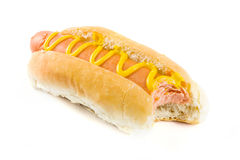 Hot dog with missing bite and mustard over white Stock Image