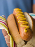 Hot Dog with Mustard. In a Napkin Stock Image