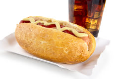 Hot-dog with mustard and ketchup in the tray with cola on white Stock Image