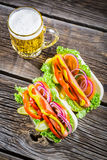 Hot dog with mustard, ketchup and vegetable Stock Photo