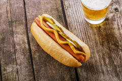 Hot dog with mustard, pickles Stock Photo