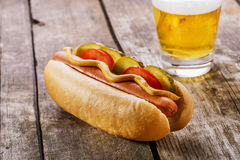 Hot dog with mustard, pickles Stock Photography