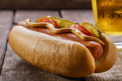 Hot dog with mustard, pickles Royalty Free Stock Photography