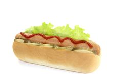 Hot dog with pickle and ketchup Stock Image