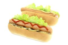 Hot dog with pickle, mustard and ketchup Royalty Free Stock Photography
