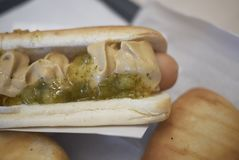 Hot dog with pickle sauce stock photos