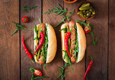 Hot dog with pickles, capers and arugula Royalty Free Stock Image