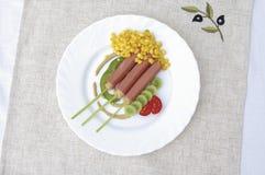 Hot dog with salad Stock Photos
