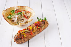 Hot dog and salad in pastry bowl Stock Photo
