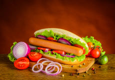 Hot Dog Sandwich with Fresh Vegetables royalty free stock photos