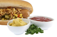 Hot Dog with sauces in bowls (clipping paths) Royalty Free Stock Image