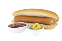 Hot Dog with sauces in bowls (clipping paths) Stock Photography