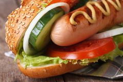 Hot dog with sausage grilled, vegetables and mustard Stock Photo