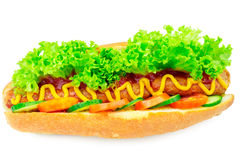 Hot dog with sausage, lettuce, tomato, cucumber, ketchup and mustard on white background. Stock Photos