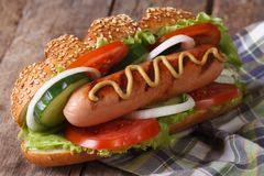 Hot dog with sausage, mustard and vegetables close up Stock Photos
