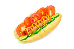 Hot dog with sausage, tomato, cucumber, ketchup and mustard on white background. Royalty Free Stock Photos