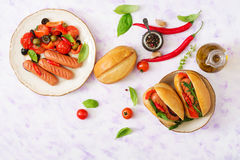 Hot dog with sausage and vegetables Stock Photo