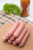 Hot dog sausages on wood pad Royalty Free Stock Image