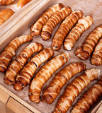 Hot dog with sesame seeds on shelf in Bakery shop Stock Photos