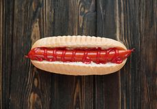 Hot dog with smoked sausage on dark wooden background.photo with. Copy space stock photo