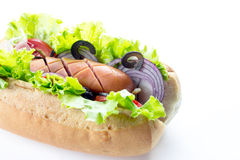 Hot-dog sur le fond blanc Images libres de droits