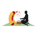 Hot-dog sur le pique-nique Datte en stationnement Aliments de préparation rapide et les gens Photographie stock