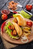 Hot dog with Tomato, lettuce, Sausage, mustard, ketchup Royalty Free Stock Photo