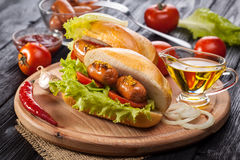 Hot dog with Tomato, lettuce, Sausage, mustard, ketchup Stock Photography