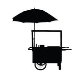Hot dog trolley wheel with umbrella silhouette Royalty Free Stock Images