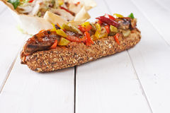 Hot dog and vegetables on bun Royalty Free Stock Photos