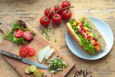 Hot dog with vegetables Stock Photos
