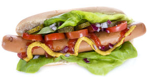 Hot Dog with vegetables (over white) Royalty Free Stock Images