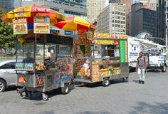 Hot dog vendor on Manhattan Street. NEW YORK–CIRCA SEPTEMBER 2015. While popular with residents and tourists, some hot dog vendors on Manhattan Streets have Stock Image