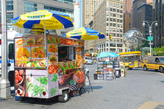 Hot dog vendor on Manhattan Street. NEW YORK–CIRCA SEPTEMBER 2015. While popular with residents and tourists, some hot dog vendors on Manhattan Streets have Stock Photography