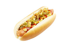Hot dog on white. Hot dog with mustard, ketchup, gherkins, and fried onions isolated on white Stock Images