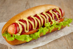 Hot dog. On wooden background stock images