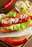 Hot-dog on wooden cutting board Royalty Free Stock Images