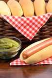 Hot dogs. Hot dog ingredients on a nice table setting rich in colors and flavors perfect for pick nicks Stock Image