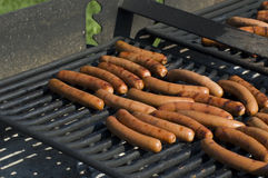 Hot Dogs. Some hot dogs grilling on hot grill Stock Photography