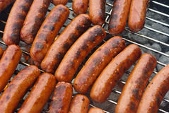 Hot Dogs on a Charcoal BBQ Grill Royalty Free Stock Photography