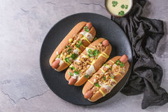 Hot dogs with cheese sauce and mustard Stock Photography