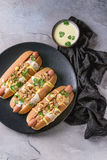 Hot dogs with cheese sauce and mustard Royalty Free Stock Photo