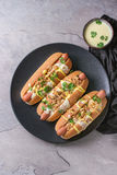 Hot dogs with cheese sauce and mustard Royalty Free Stock Image