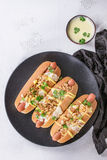 Hot dogs with cheese sauce and mustard Royalty Free Stock Photography