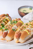 Hot dogs with cheese sauce and mustard Stock Photos