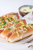 Hot dogs with cheese sauce and mustard Stock Image