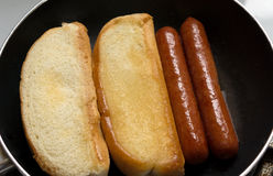 Hot Dogs Cooking In Pan Close Royalty Free Stock Image