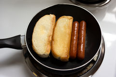 Hot Dogs Cooking In Pan Stock Photos