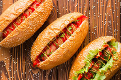 Hot dogs of different flavors on a cutting board Stock Photography