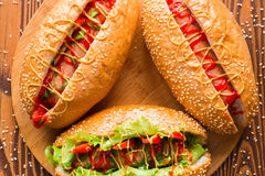 Hot dogs of different flavors on a cutting board Royalty Free Stock Image